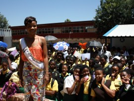 Boipelo Mabe with Pholosho Junior Secondary School children who are fully behind her to bag the title of Miss South Africa 2017.