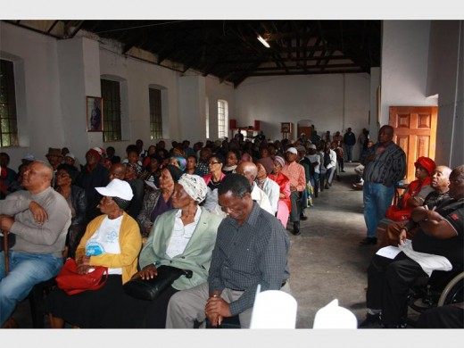 Alpoa members listen attentively during a feedback meeting at the Roman Catholic Church hall.