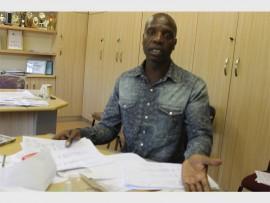 Kwabhekilanga Secondary School deputy principal Sehlano Makwela goes over the matric results.