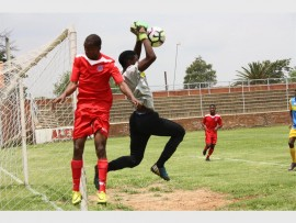 Gauteng FC's Ramotsepa Nthite (red) tussles for the ball in the goalmouth with Soweto Panthers keeper, Tumelo matsunyane.