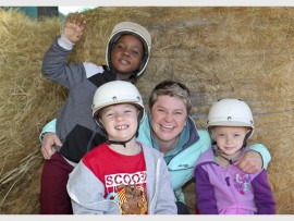 Horsing around with Tanya Visser, editor of The Gardener magazine, are Lwazoluhle Mhlongo, Connor Smith and Paige Biggar from the Browns' School pre-primary.
