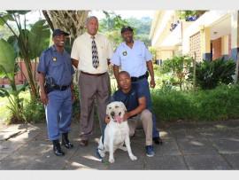 Cpt Bongani Dube, Clinton Martin (PBHS disciplinary officer), W/O Muzi Maphumulo and Cst Musa Khwela with Johnny.