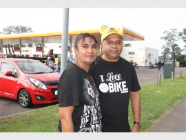 Shanita and Sudesh Khelawan watch the cyclists ride along the M19 Pinetown.