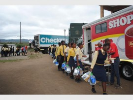 Pupils from Mnyakanya High School in Ntolwane, KwaZulu-Natal receive their water donations from Shoprite. PHOTO: Submitted