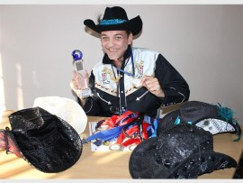 Kevin Ellis with his collection of medals and certificates of achievement from the World Dance Masters Championships and the South African Masters Championship recently.