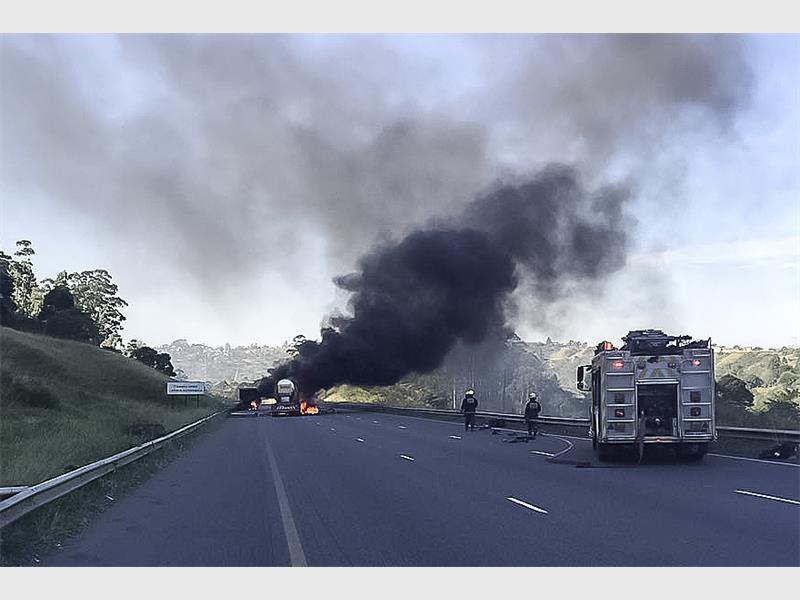The oil truck went up in flames after the accident near the toll plaza. PHOTO: Chris Botha