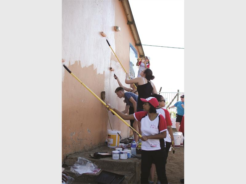 The Unlimited volunteers giving a crèche a make-over.