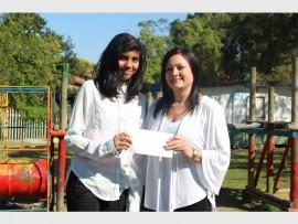 Laeeqa Hoosen hands over her donation to Malvern Children's Home PR Officer, Lee Jarret. PHOTO: Thobele Nzama