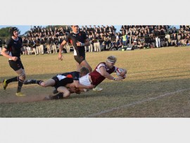 Kearsney's Dylan Richardson scores a try against Clifton College.