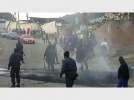 Malvern police extinguish the fire from burnt tyres. PHOTO: Submitted