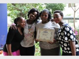 Buyile Ngwenya, Thembi Gasa and Ruth Gasa congratulate their colleague Doris Majozi (centre) on her Hirsch's hero award.
