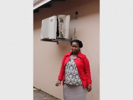 Nomvula Mgenge, a social worker at the Open Door Crisis Care Centre, next to the vandalised air conditioner.