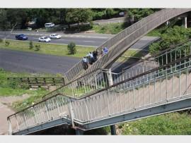 W/O Muzi Maphumulo (Pinetown SAPS), Matthews Buthelezi (Pinetown CPF's chairman), Melanie Brauteseth (ward 18 councillor), Thys Janse van Rensburg (active patroller)and chairman of the community control room, Justin Bosse on the problematic M13 footbridge.
