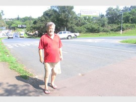 Gert van der Linde, a Pinetown resident, stands in front of the busy intersection which he believes needs more road signs.