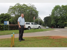 Local resident and member of the Forest Hills 1 Community Watch, Craig Perry, near the dangerous intersection.