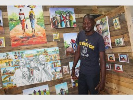 Paul Muzefani with some of the paintings on show at the Woza Moya Gallery in Botha's Hill.