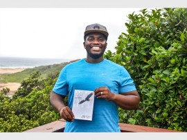 Mqondisi Shozi with his new book.