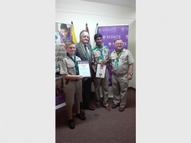 Dominic Nel, Dr Dudley Forde, Devlan Govender and Group Scouter, Guy Caws with their citations at the recent KZN Scout Awards ceremony. PHOTO: Submitted