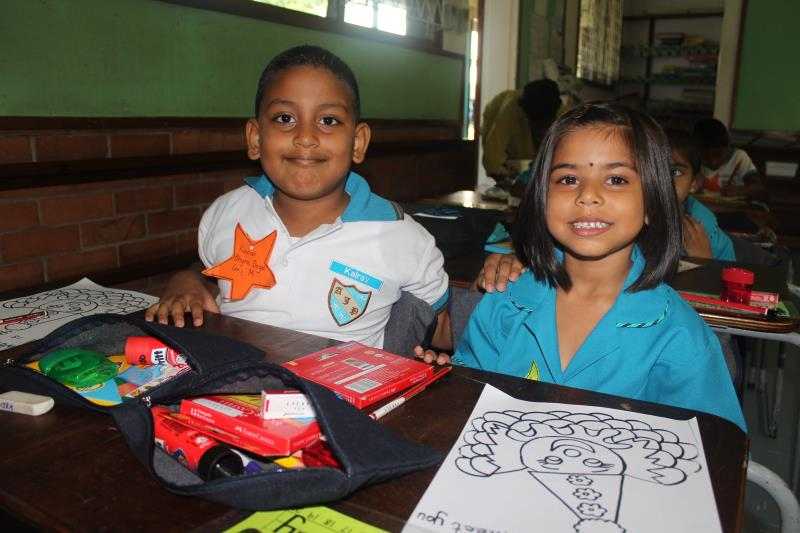 Kairav Bhyro Deyal and Tashmika Panday enjoy coloring together on their first day of school.
