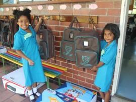 Kimaya Naicker and Cayley Govender hang up their bags before class.