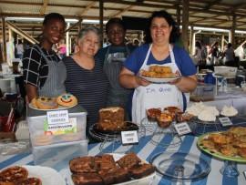 ZinhlenPhunyula, Archondia Ovrenovits, Samke Msomi and Maria Moutzouris (owner of Fournaki  Greek Food with their delicious sweet treats at the market.