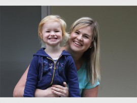 Emily Galloway and her mom Lauren win the biggest happiest first day smile. Emily joins the  Weavers' Nest Grade 0000 class (2 turning 3) the youngest group in Highbury's history.