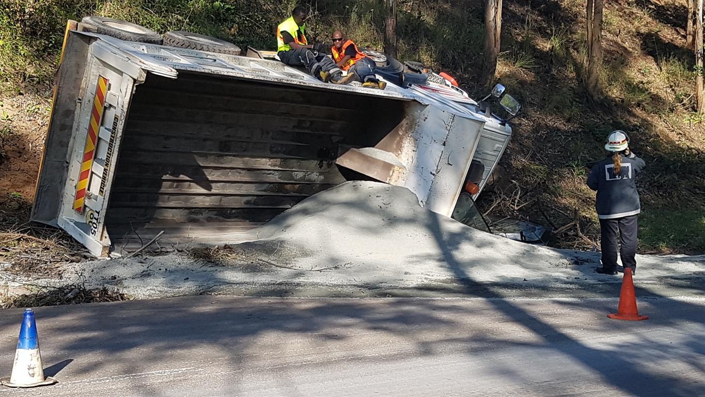 Truck overturns in cliffdale