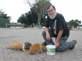 Dough Fairall, of Feral Cats Rescue Trust, with one of the many successful cat colonies that he feeds and maintains.