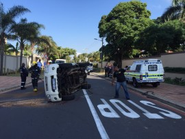 The car flipped on to its side. PHOTO: Crisis Medical