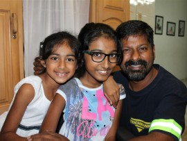 Nicole Padayachee (centre) with her younger sister, Jordan, and father, Jay.