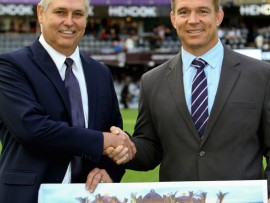 Sun International regional manager, Melville Vogel hands over a cheque to John Smit for Barney's Army. PHOTO: Justin Fuchs.