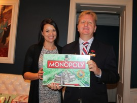 Belinda Maritz, a Hasbro representative, and Wayne Coetzer, general manager of The Oyster Box Hotel with the newly launched South African inspired Monopoly game.