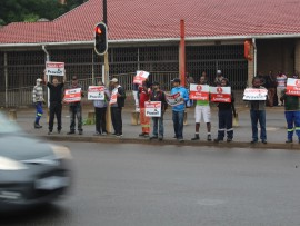 The protest took place outside the Redhill Post Office on Friday morning.