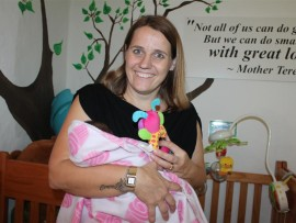 Joanne Teunissen with The Durban North Baby Home's newest member.