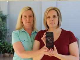 Liane Davies and Michelle Amaral hold up a picture of their beloved cat, Chloe, that was killed in a hit-and-run last Friday. They are urging to City to install speed calming measures to stop people speeding on Oakleigh Avenue.