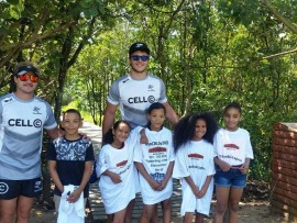 Cell C Sharks players with youngsters who attended the clean up at Blue Lagoon.