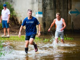 Juan Botsis splashing his way through the Umhlanga River with uMhlanga's Glen Gore closely behind him at last year's uMhlanga Trail Run. PHOTO: Anthony Grote