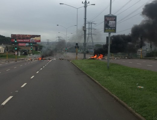 Burning tyres and debris strewn across uMgeni Road.