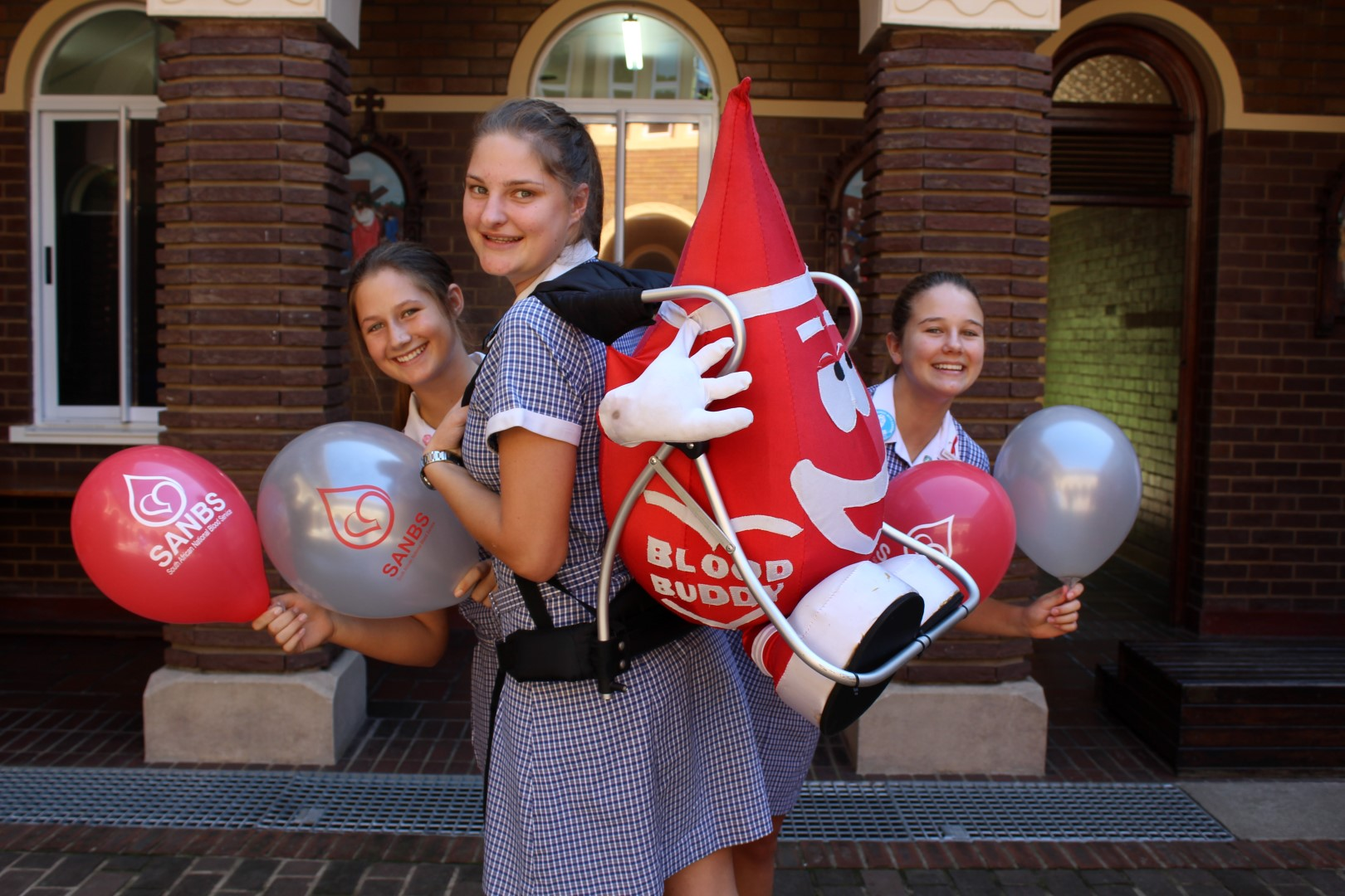 Sarah Rich, Caitlin Slade, and Hannah James urge residents to come out and support the school's blood drive on Wednesday, 29 March from 9am to 5pm at the Parish Hall.