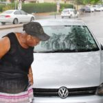 Pretty Gwambe (66) surveys the damage to her car after an attempted hijacking incident on Tuesday.