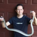 Jason Arnold shows off the 2.4 metre black mamba.