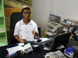 Nonhlanhla Sithole, who works at Umhlanga Tourism, holds up the fake acceptance letter the scam artists have been using to target those desperate for jobs.