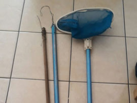 The improvised broom handle and the pool scoop.
