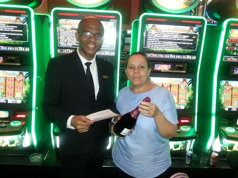 Gaming floor manager, Dumisani Ngubane and the winner of the R1.8-million, Nola Lawrence.
