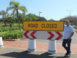 Umhlanga Councillor Heinz de Boer standing infront of the closed road Millennium Boulevard, between Zenith Drive and Centenary Boulevard.
