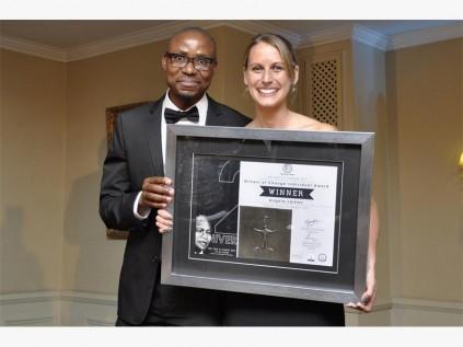 Bhekinkosi Moyo from Southern Africa Trust hands the individual category award to Angela Larkan.
