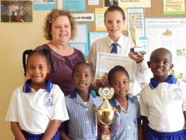Reducing carbon footprints: Merlewood Primary teacher Martie van Rooyen (back, left) is proud of Jordan Trusler (back, right) who came third in the recent HCM recycling competition, and pupils (front, from left) Hannah Reddy, Phiwe Mkhize , Awethu James and Sinqobile Zulu for taking part and gaining valuable experience.