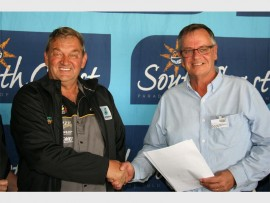Signed and sealed: Ugu South Coast Tourism's CEO Justin Mackrory (right) shakes hands with Des Gutzeit cementing the initial five-year agreement. 2477vee