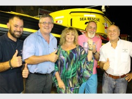 NSRI Shelly Beach's acting station commander Jeremiah Jackson (left) and NSRI operations board chairman Eddie Noyons (far right) thank (from left) Jean Grundlingh of Seal Con Systems, Carol Best of Flowcrete and Mike Kennon who did the hard work - laying the new floor.