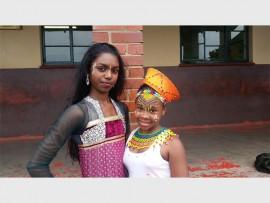 Kiara Nandhoo (left) and Wandiswa Ntenza from Jai Hind show off their beautiful national costumes.